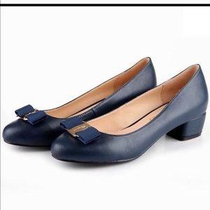 Navy Ferragamo short heeled shoes